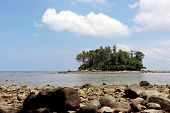 Tropical Beach With Stones, View To The Sea And Green Island With Palm Trees, Selective Focus. Conce poster