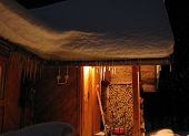 Mountain Alpine Hut Under Snow At Night