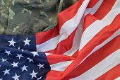 United States Of America Flag And Folded Military Uniform Jacket. Military Symbols Conceptual Backgr poster