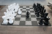 Chess Kit. Giant Chess Game in a public area. People can play a Giant Chess Game as they enjoy a nic poster