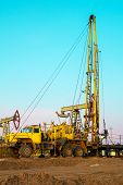 Special Equipment For Drilling An Oil Well In An Oil Field. Workover Rig Working On A Previously Dri poster