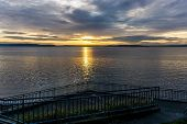An Overcast Cloudy Sunset Over The Puget Sound In West Seattle, Washington. poster