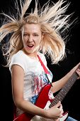 Woman playing the electrical guitar and have fun