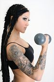 Young Tattooed Stylish Woman Exercising With Old Dumbbells
