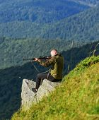 Hunter Hold Rifle. Hunter Spend Leisure Hunting. Hunting In Mountains. Man Brutal Gamekeeper Nature  poster