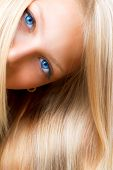 Blond Hair. Blonde Girl with Blue Eyes. Healthy Long Blond Hair. Hair Extension