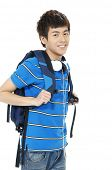 young man in jeans standing man with backpack with headphones.
