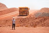 picture of mines  - Mining truck working in iron ore mines Western Australia - JPG