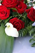 Arum Lily In A Bridal Bouquet Of Red Roses