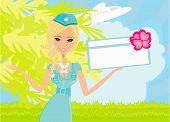 Schöne Stewardess mit Ticket