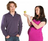 picture of gullible  - Frustrated man and pregnant woman pointing at condom - JPG