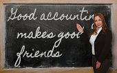 Teacher Showing Good Accounting Makes Good Friends  On Blackboard