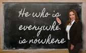 Teacher Showing He Who Is Everywhere Is Nowhere On Blackboard