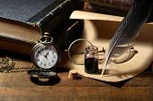 stock photo of inkpot  - Vintage still life with inkpot and feather near watch and books - JPG