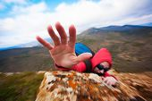 climber's Hand climberind on the rock