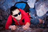 woman tourist looks for way from the rocks top