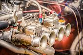 stock photo of carburetor  - old carburetor closeup on a rusty classic sportscar engine - JPG