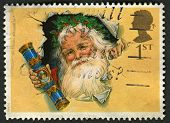UK - CIRCA 1997: A stamp printed in UK shows image of The Father Christmas with Traditional Cracker,