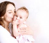 stock photo of cute kids  - Mother and Baby kissing and hugging - JPG