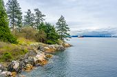 Fragment of a rocky beach with gorgeous view at Ocean, British Columbia, Canada.
