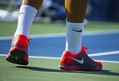 Seventeen times Grand Slam champion Roger Federer wears custom Nike tennis shoes at US Open 2013