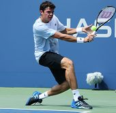 Professional tennis player  Milos Raonic during first round singles match at US Open 2013