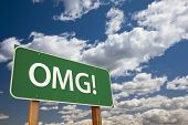 OMG!, Texting Abbreviation for Oh My Gosh, Green Road Sign with Dramatic Sky and Clouds.