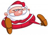 Upset Santa Claus sitting on the floor with crossed arms