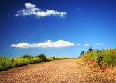 Deserted Country Road Under Beautiful Blue Sky