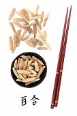 Lilyturf root chinese herbal medicine with mandarin title script translation and chopsticks. Mai don