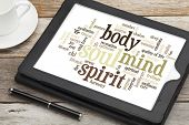 mind, body, spirit and soul - word cloud on a  digital tablet
