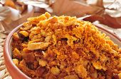 a bowl with migas, a traditional dish in the spanish cuisine made with breadcrumbs