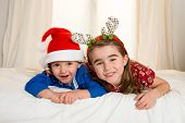Happy Cute Little Kid And His Sister At Christmas