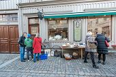 Window shoppers in historic Haga of Gothenburg, Sweden