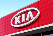 Samara, Russia - November 23: The Emblem Kia Motors On Blue Sky Background, November 23, 2013 In Sam