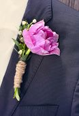 Groom Wearing A Purple Tulip Buttonhole