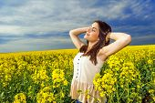 Portrait of woman relaxing in yellow colored field