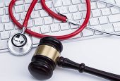 Gavel and stethoscope at the keyboard