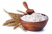 picture of cereal bowl  - flour with wheat in a wooden bowl and shovel on a white background - JPG