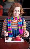 Beautiful Girl In Colorful Clothes In A Parisian Street Cafe
