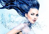 Fashion model girl with water splash collar and long blowing blue hair. Fantasy Woman. Mermaid. Fresh Water splashing