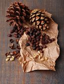 picture of pine nut  - Cedar pine nuts on wooden table - JPG