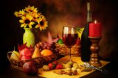 stock photo of wine-glass  - Beautiful still life image of red wine fruits and nuts with dramatic lighting - JPG