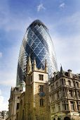 LONDON, UK - APRIL 24, 2014: Gherkin building in the City of London leading centre of global finance