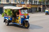 BANGKOK, THAILAND - MARCH 23: Unidentified man drives tuk tuk on March 23, 2014 in Bangkok, Thailand
