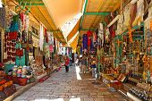 JERUSALEM, ISRAEL - AUGUST 21, 2013: Bazaar in Old City of Jerusalem with variety of middle east tra