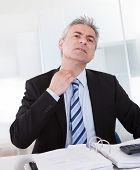 Mature Businessman Feeling Uncomfortable