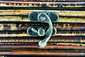 picture of hasp  - Wooden background with little iron hasp - JPG