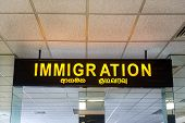 COLOMBO, SRI LANKA - FEBRUARY 19, 2014: Immigration sign at Bandaranaike International Airport, one
