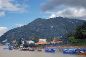 Fishing boats  junks on the river on the background of mountains in Nha Trang Vietnam